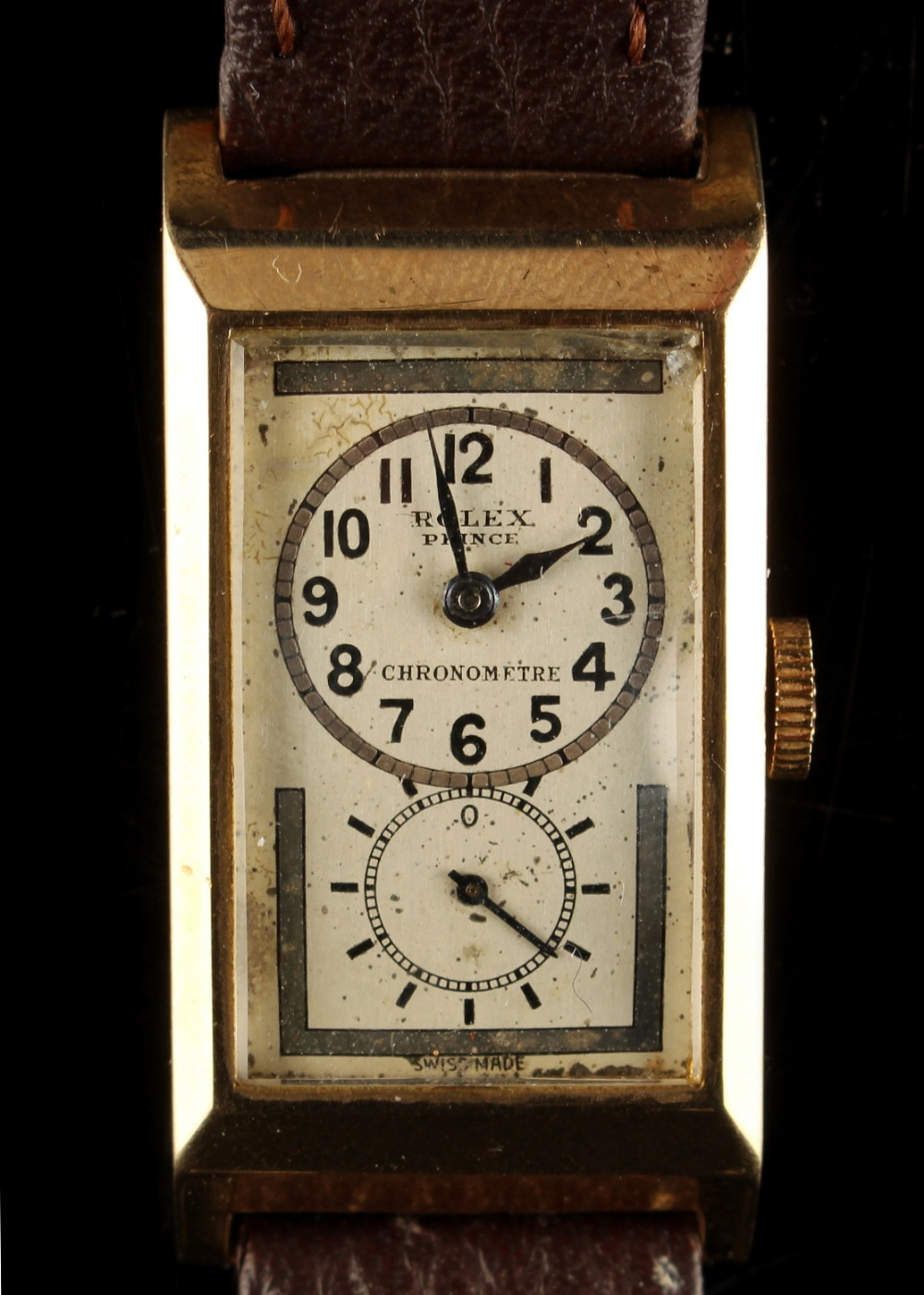 Lot 231 - A 1930's gent's Rolex Prince 9ct yellow gold tank cased wristwatch, the dial with subsidiary seconds