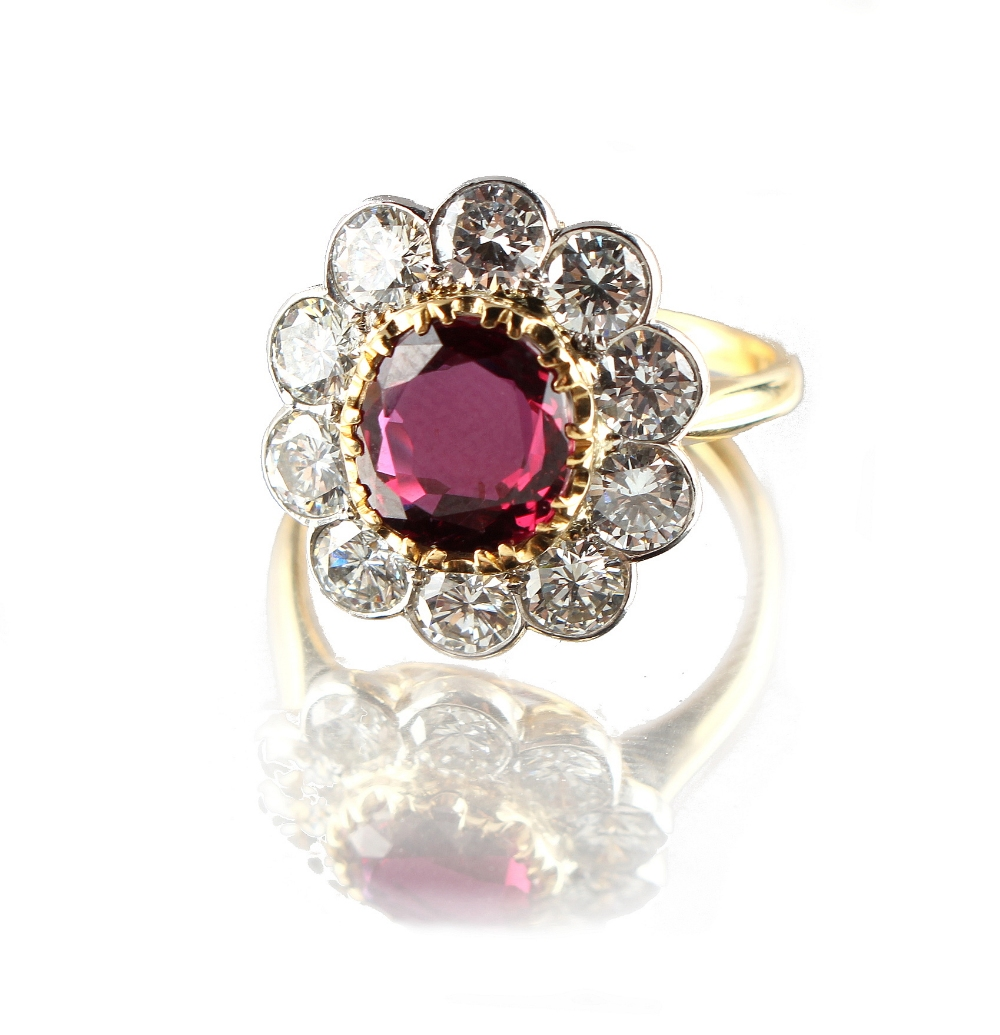 Lot 251 - A fine 18ct yellow gold ruby & diamond flowerhead cluster ring, the certificated untreated Thai oval