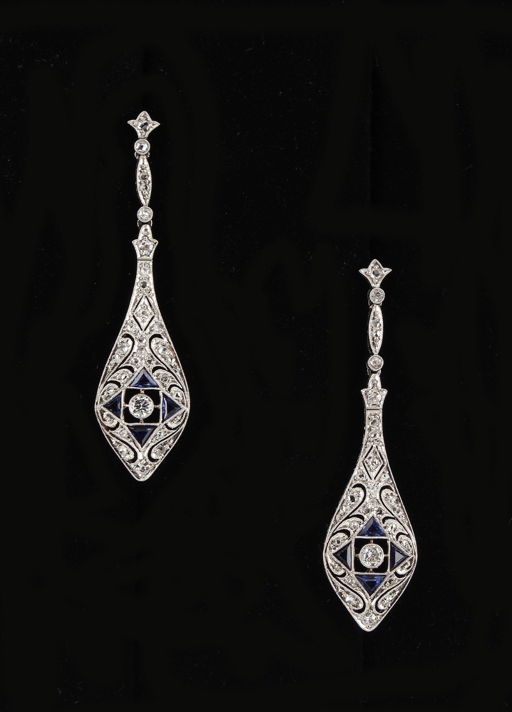 Lot 259 - A pair of Belle Epoque style sapphire & diamond pendant drop earrings, for pierced ears, each with