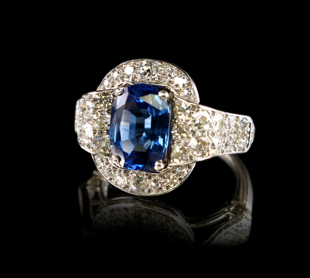 Lot 270 - A very fine platinum sapphire & diamond cluster ring, of buckle form, the certificated untreated