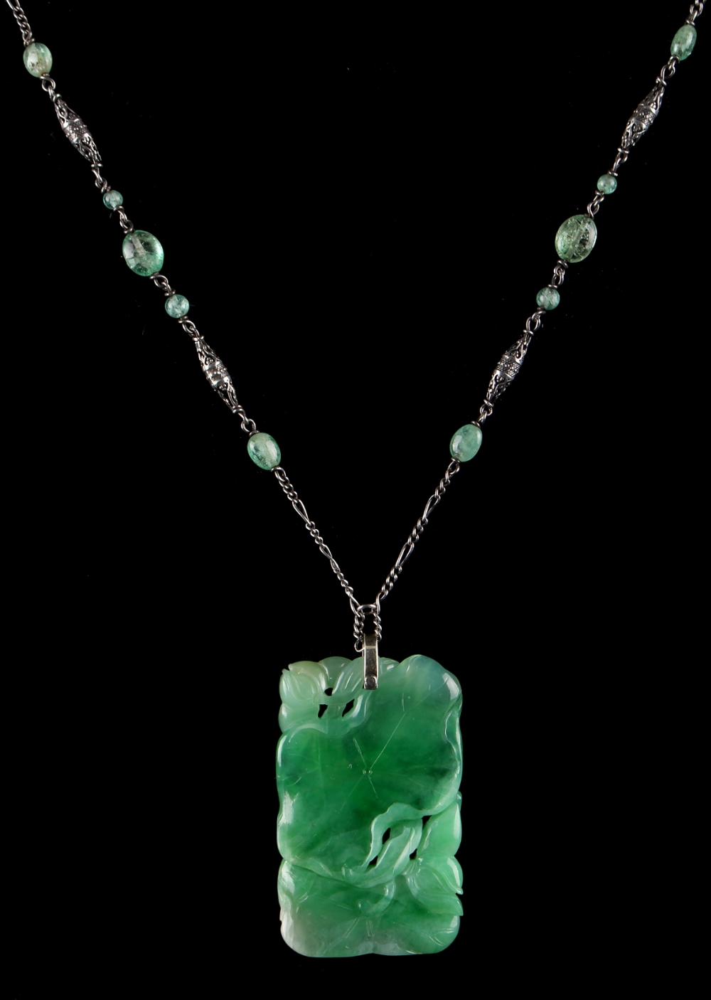 Lot 215 - A large Chinese carved jadeite lotus pendant with diamond set suspension loop, on later associated