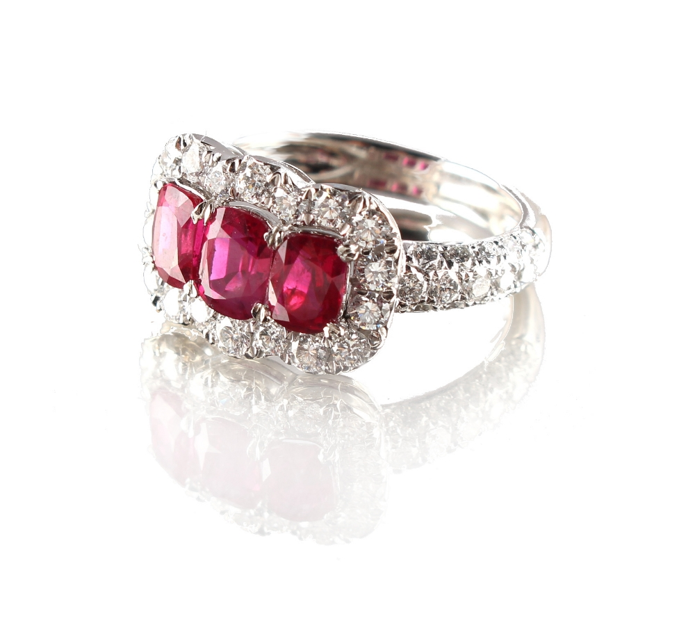 Lot 268 - A fine platinum ruby & diamond ring, with three certificated untreated Burmese cushion cut rubies