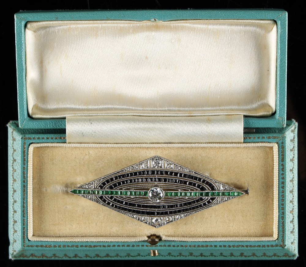 Lot 232 - An Art Deco diamond emerald & black onyx brooch, with round cut diamonds, calibre cut emeralds &