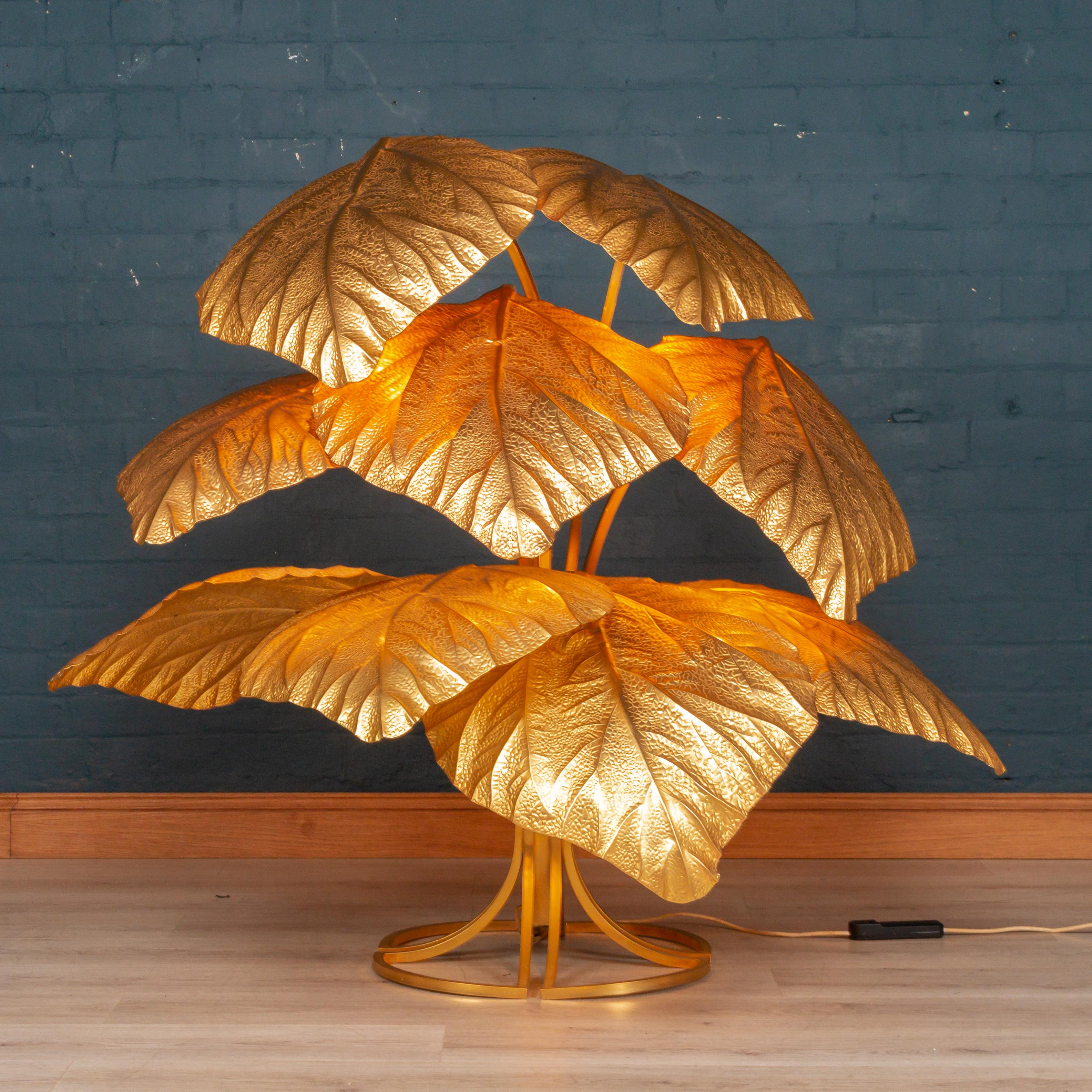 Lot 144 - Decorative/Interior Design: A nine leaf brass floor lamp by Tommaso Barbi, Italian, circa 1970