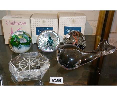 Three Caithness glass paperweights with boxes, together with an Art glass whale and Kosta crystal paperweight