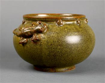 Lot 5027 - Chinese green glazed ceramic jar, with a rolled rim above a band of bosses, the shoulder of the
