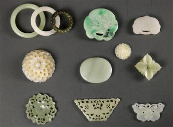 Lot 5036 - (lot of 12) Chinese hardstone plaques and carvings, including three rings (huan); four flowers;