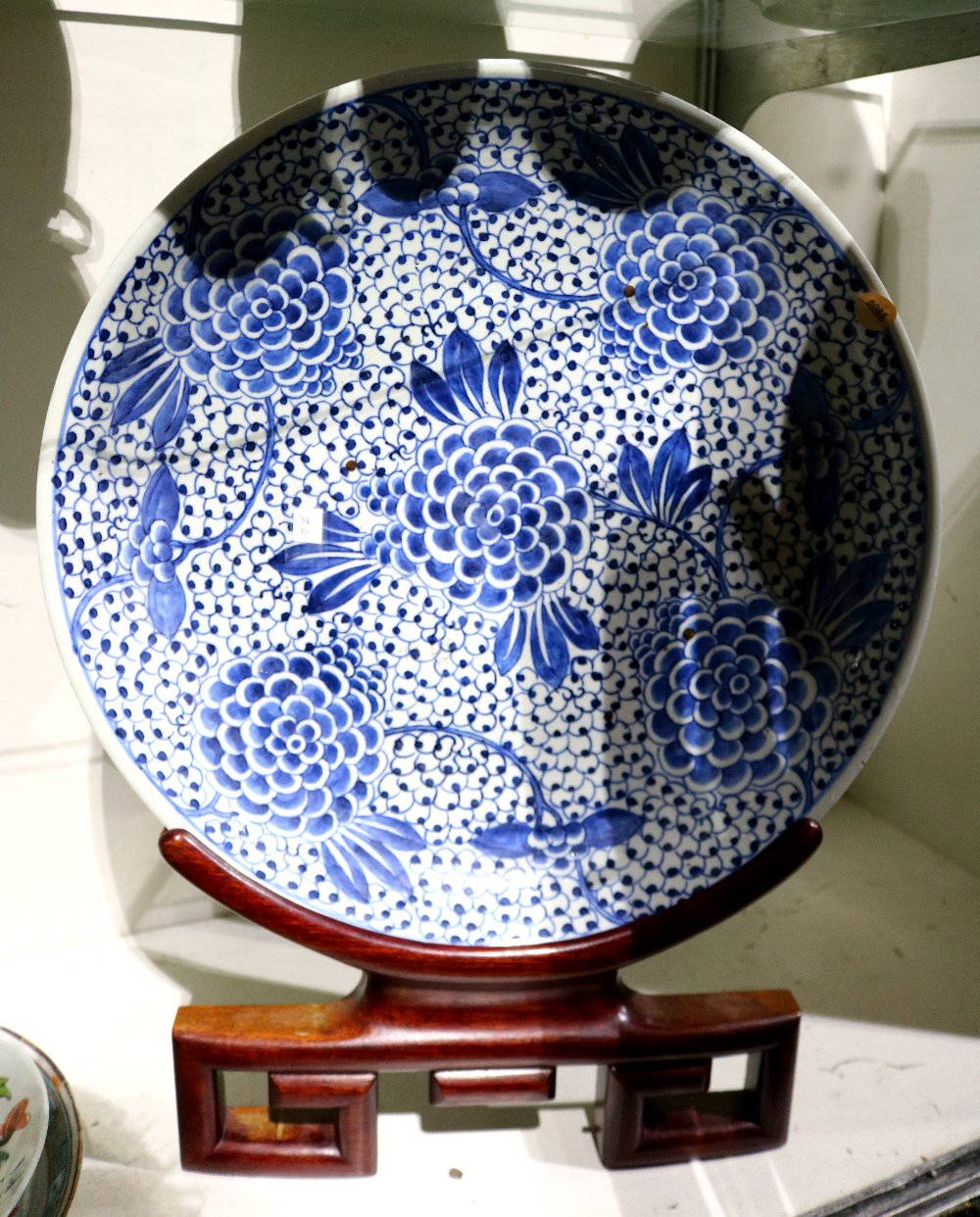 Lot 5085 - Chinese underglaze blue porcelain charger, featuring tendrils issuing large blossoms on a dense