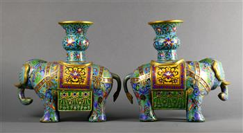 Lot 5032 - Pair of Chinese cloisonne enameled vessels, each of a carparisoned elephant supporting a gu-vase