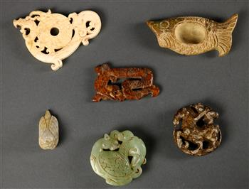 Lot 5033 - (lot of 6) Chinese archaistic hardstone carvings, including a fish with a well to the center; a