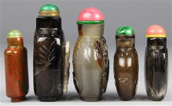 Lot 5051 - (lot of 5) Chinese stone snuff bottles: first, of rutilated quartz (hair crystal) with a flattened