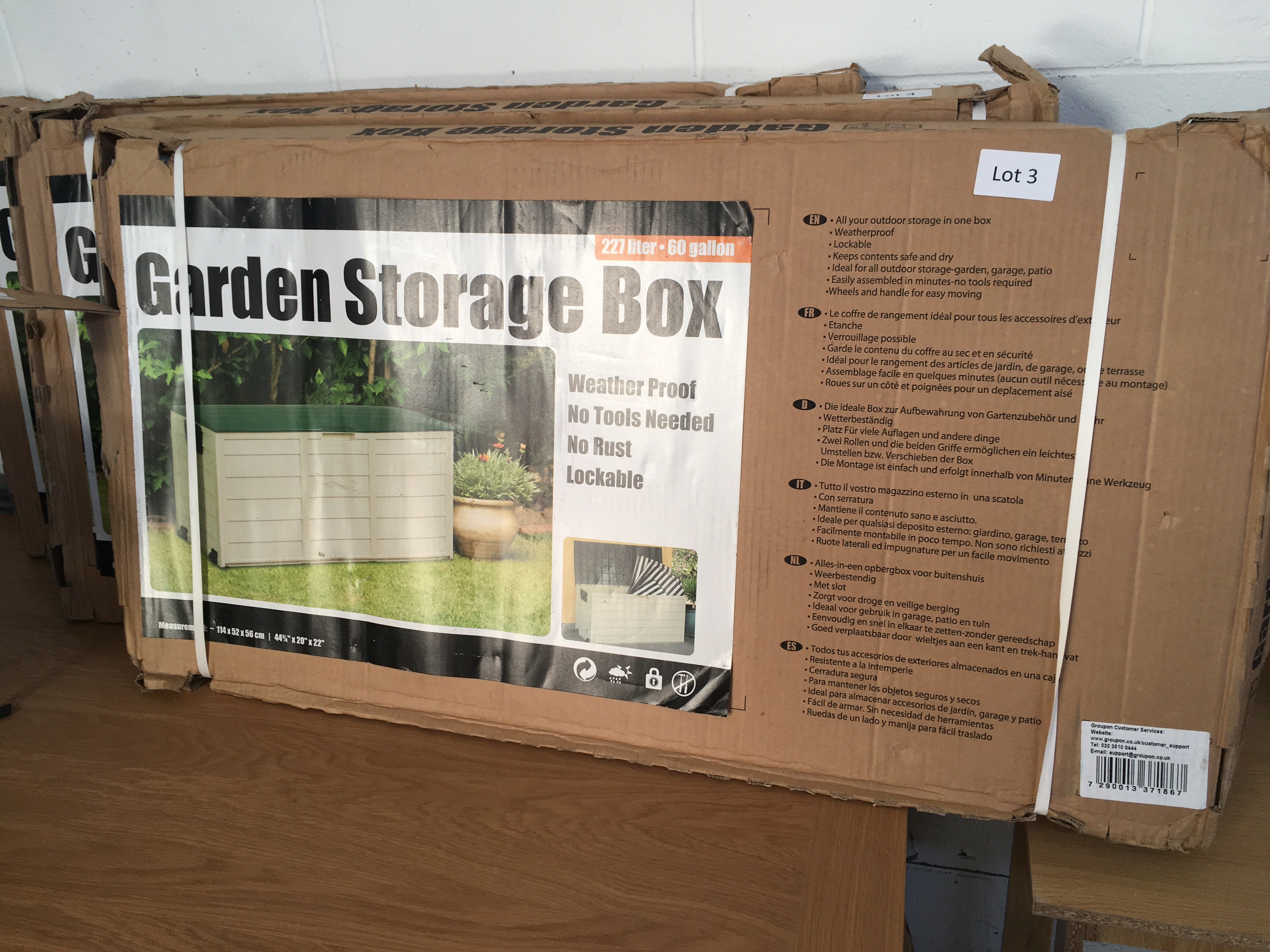 Lot 5 - 227 litre garden storage box. Bad packaging.