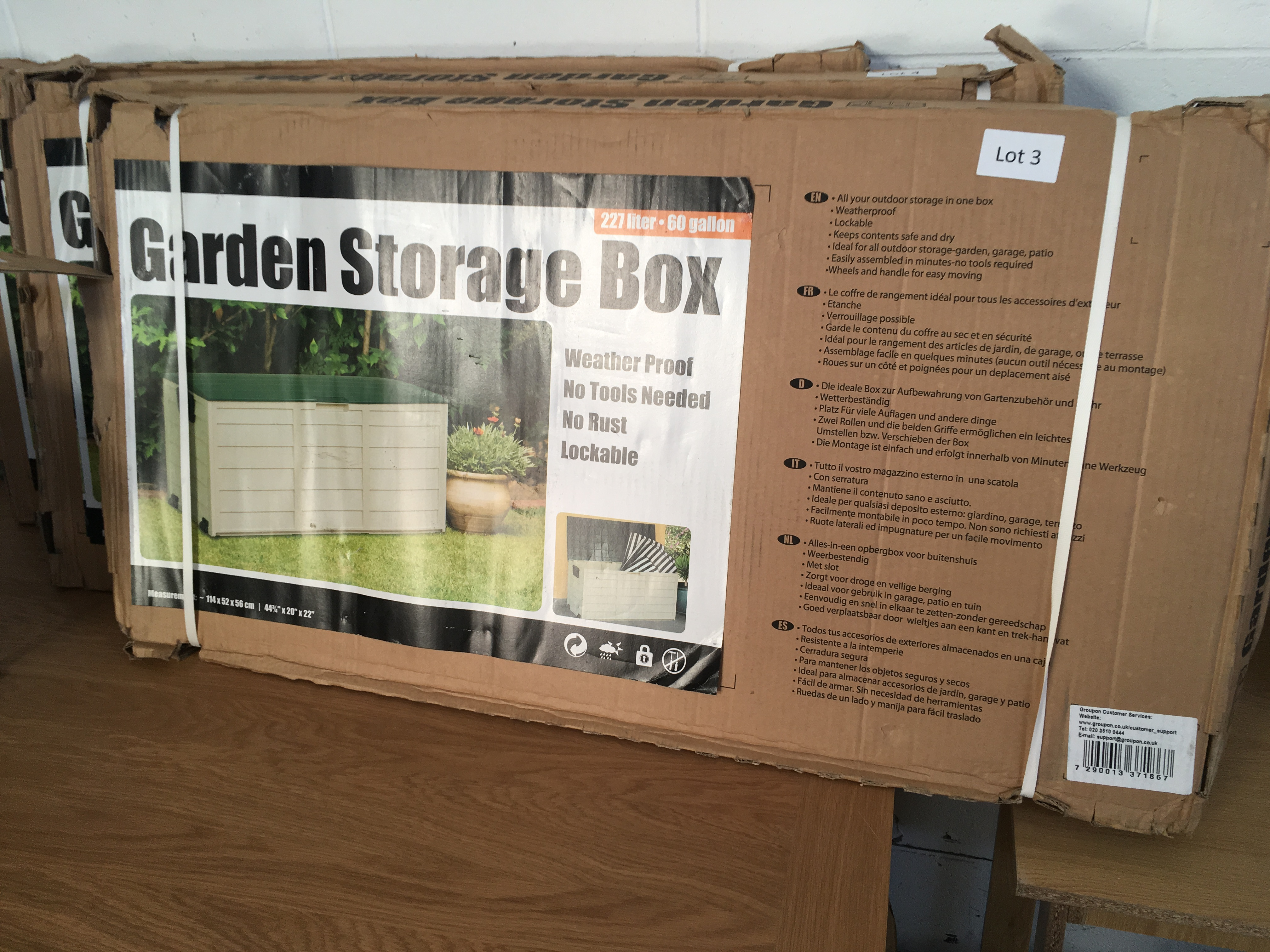 Lot 3 - 227 litre garden storage box. Bad packaging.