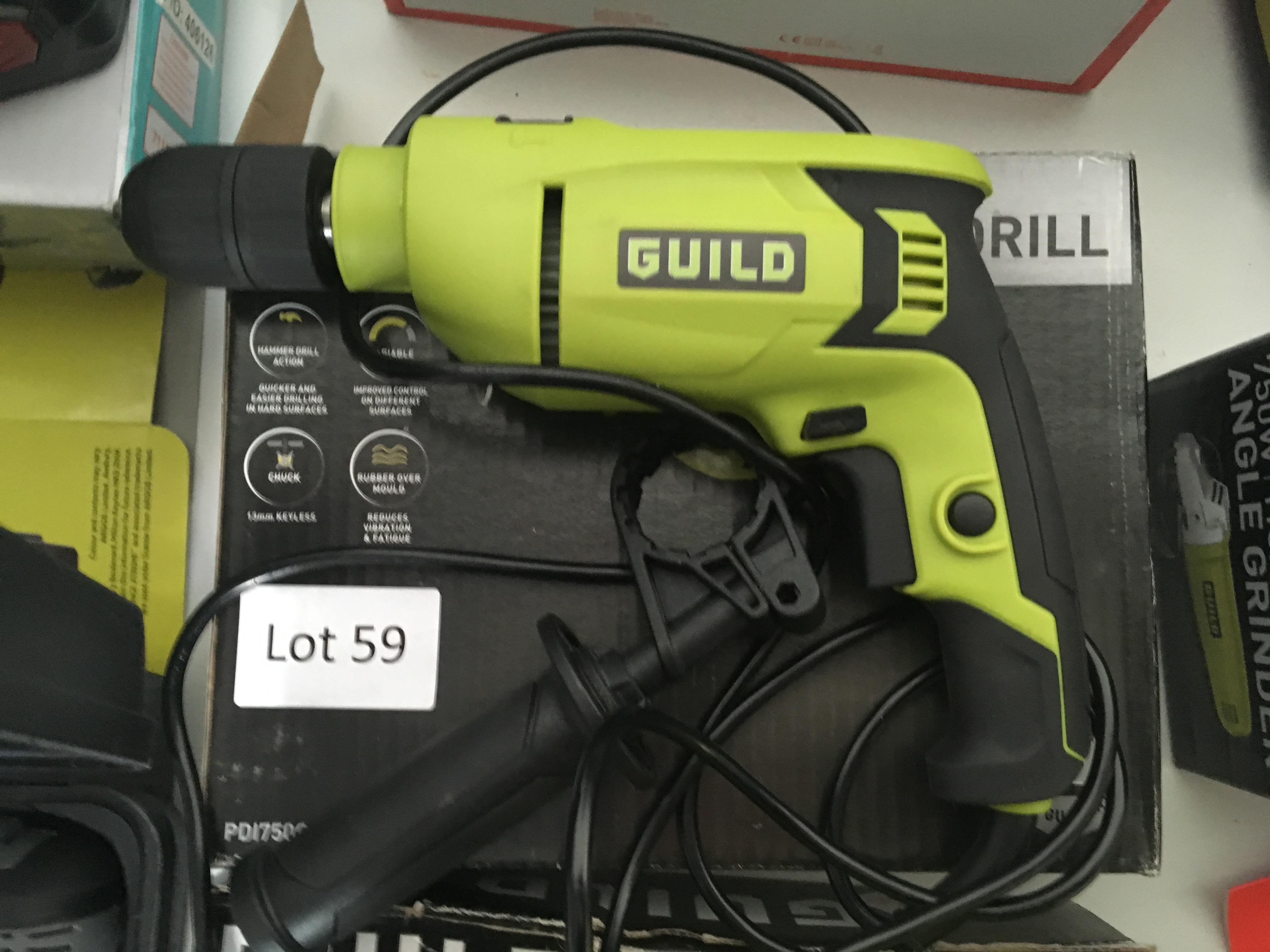 Lot 59 - Guild 750W hammer drill. Working, bad packaging.