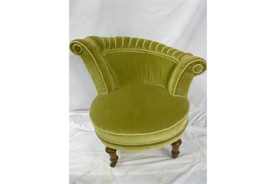 An Unusual Victorian Occasional Chair Upholstered In Green Velvet With  Sloping Scroll Back And Sh