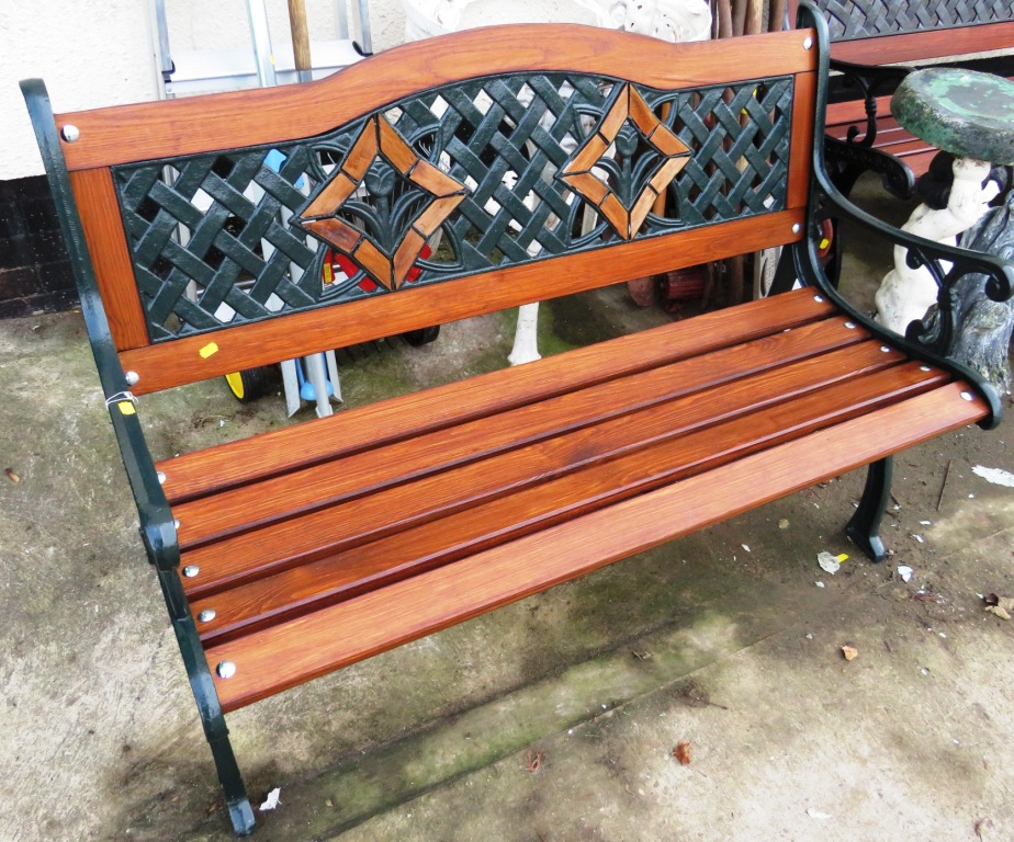 Lot 32 - PAINTED CAST METAL AND WOODEN SLATTED GARDEN BENCH WITH FLORAL DESIGN TO BACK