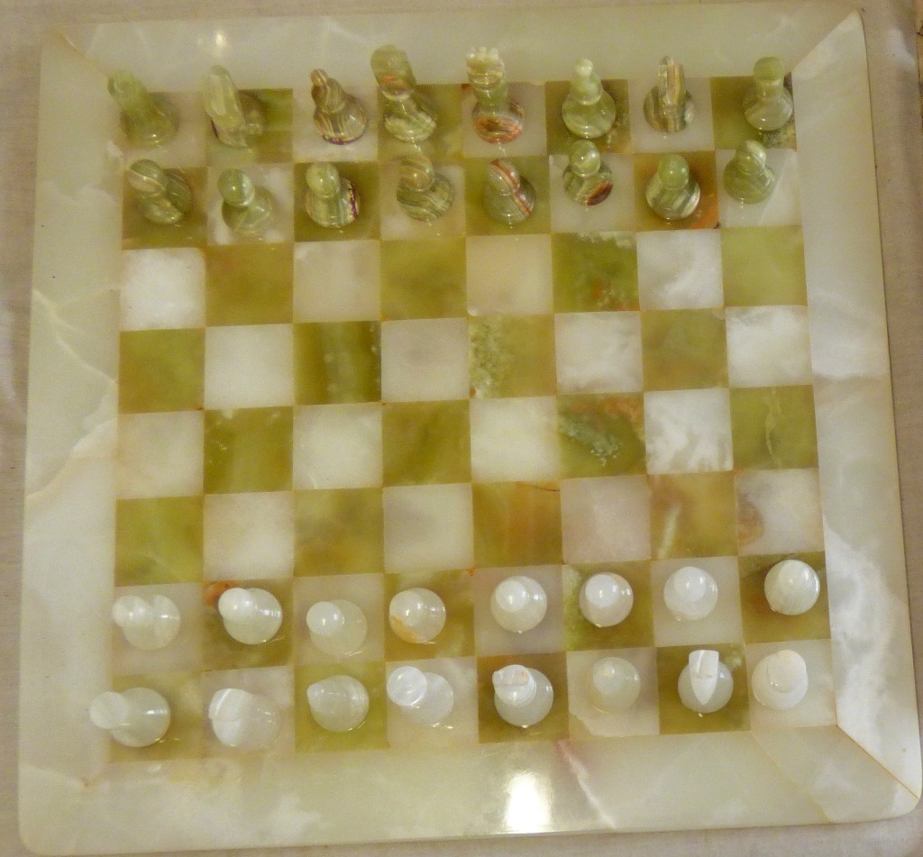 Lot 29 - Handmade White and Green Onyx Marble Chess Game Chess Set of Chinese Origin. One white bishop has