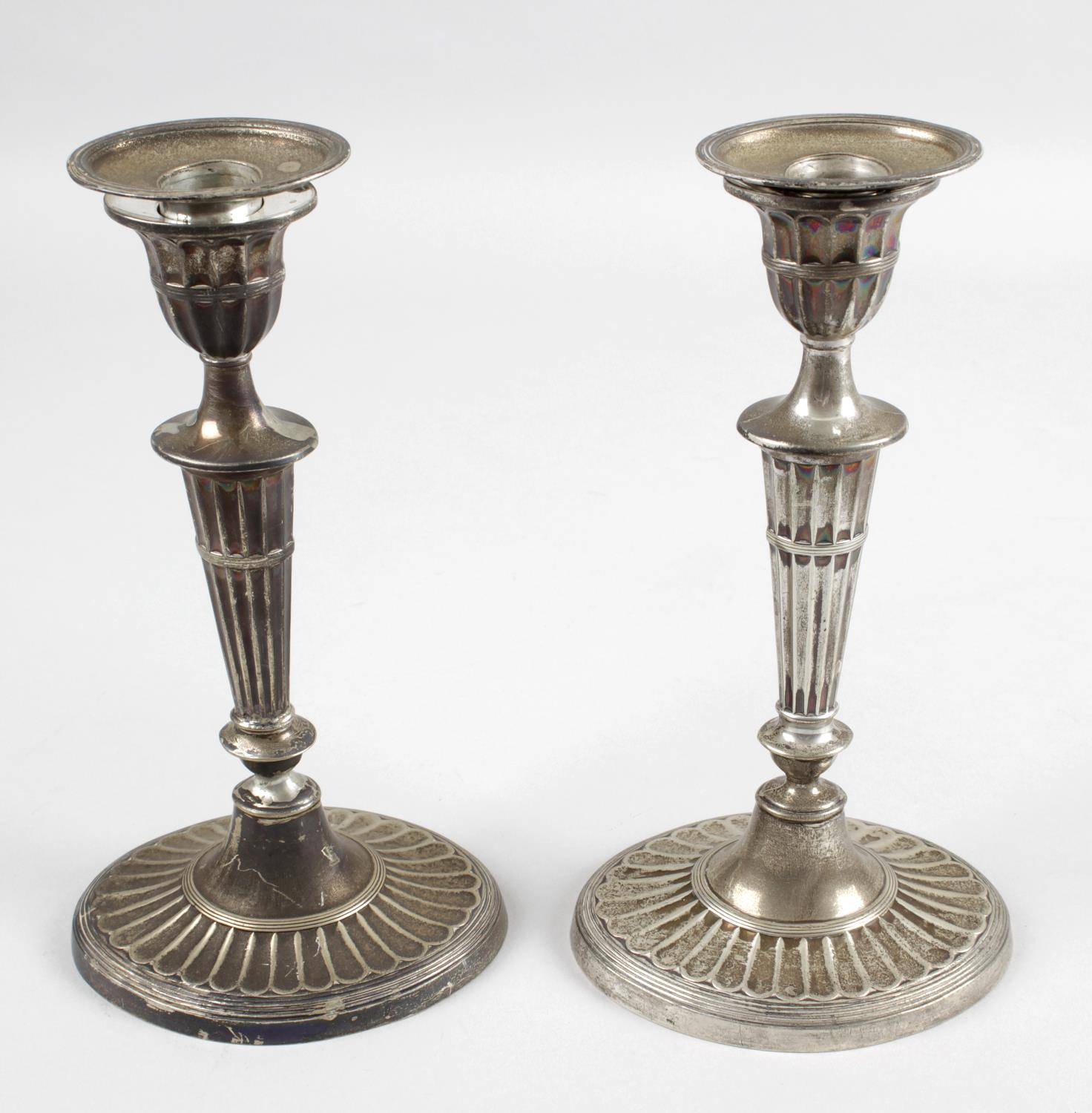 A pair of Edwardian silver mounted candlesticks,