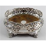 A large Victorian silver mounted coaster,