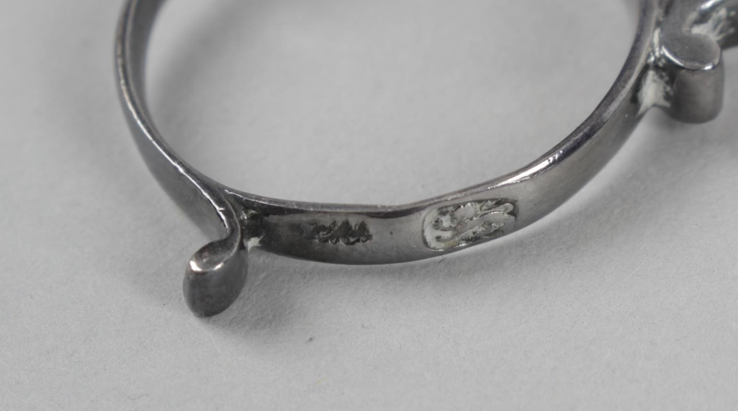 Lot 37 - A pair of mid-eighteenth century silver sugar nips of scissor form with personally initialled hinge