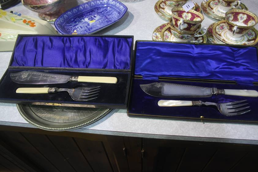 Lot 10 - Two cased fish servers etc.