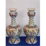 A pair of early 20th century Delftware pottery vases in earlier Persian style; thistle-shaped