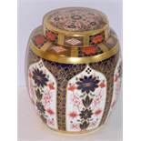 A Royal Crown Derby jar and cover; hand-gilded and decorated in the 1128 pattern (17.5cm)
