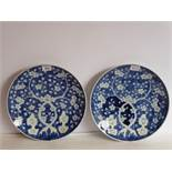 A pair of Chinese porcelain dishes; each hand-decorated in underglaze blue with prunus blossom and