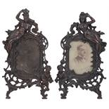 A pair of late Victorian patinated spelter photograph frames