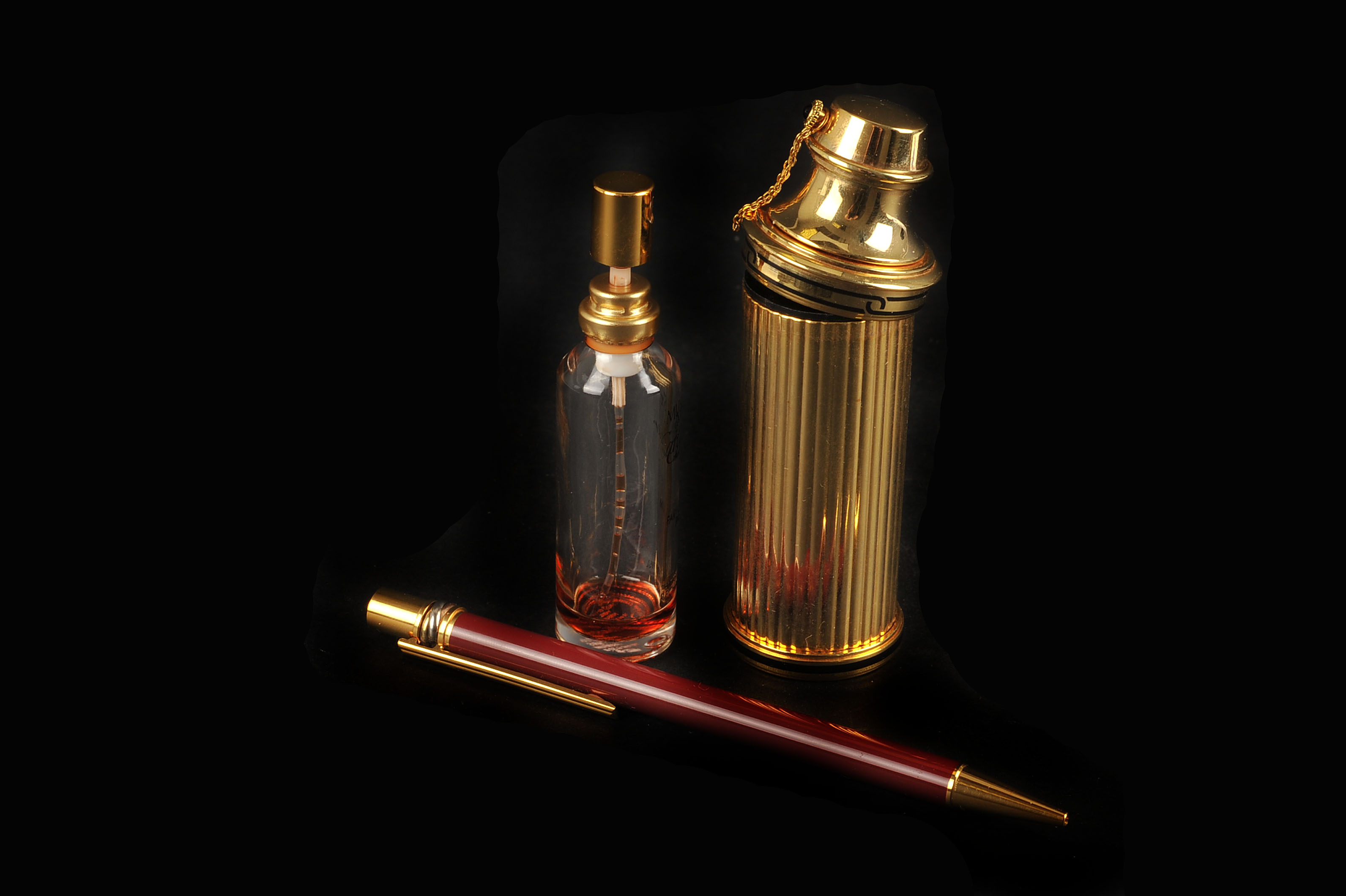 A Must De Cartier Perfume Atomiser Together With A Gold Plated And