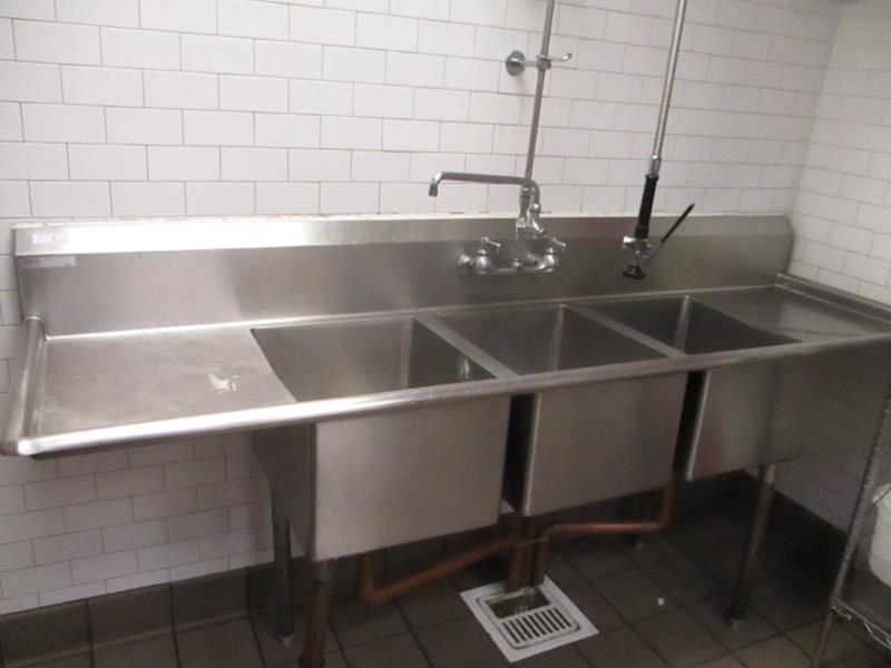 Lot 1 - Three Compartment Sink w/ Dual Side Drainboards & Sprayer, One Legs Needs To Be Welded