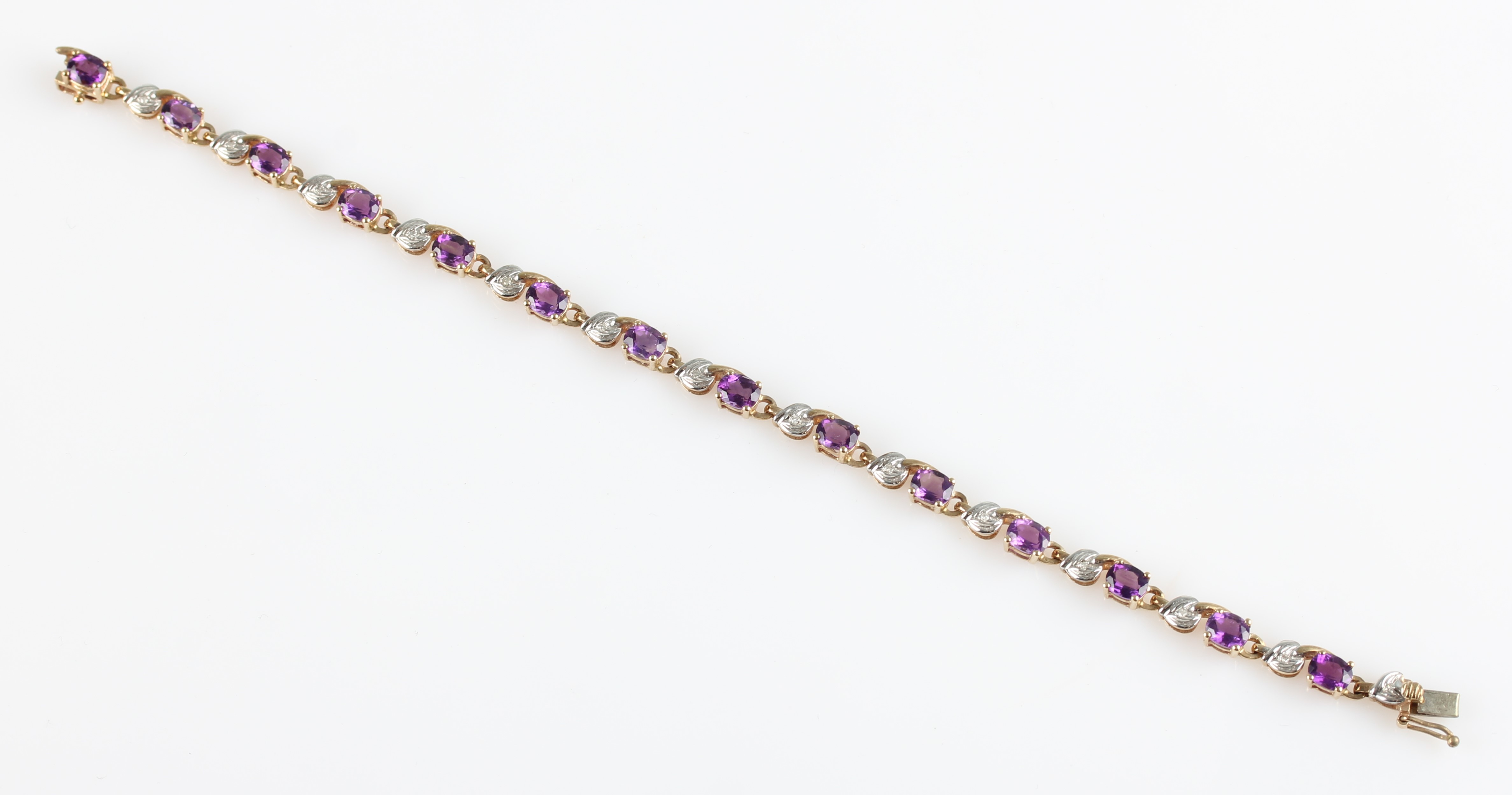 Lot 53 - A hallmarked 9ct yellow gold amethyst and diamond bracelet, set with fourteen oval cut amethysts and