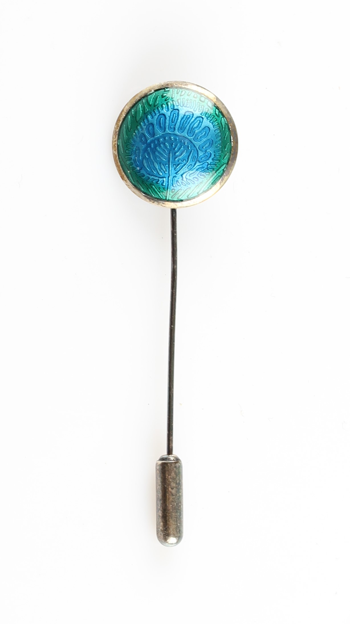 Lot 4 - A Liberty & Co. silver and enamel stick pin, the circular metalwork featuring green to blue