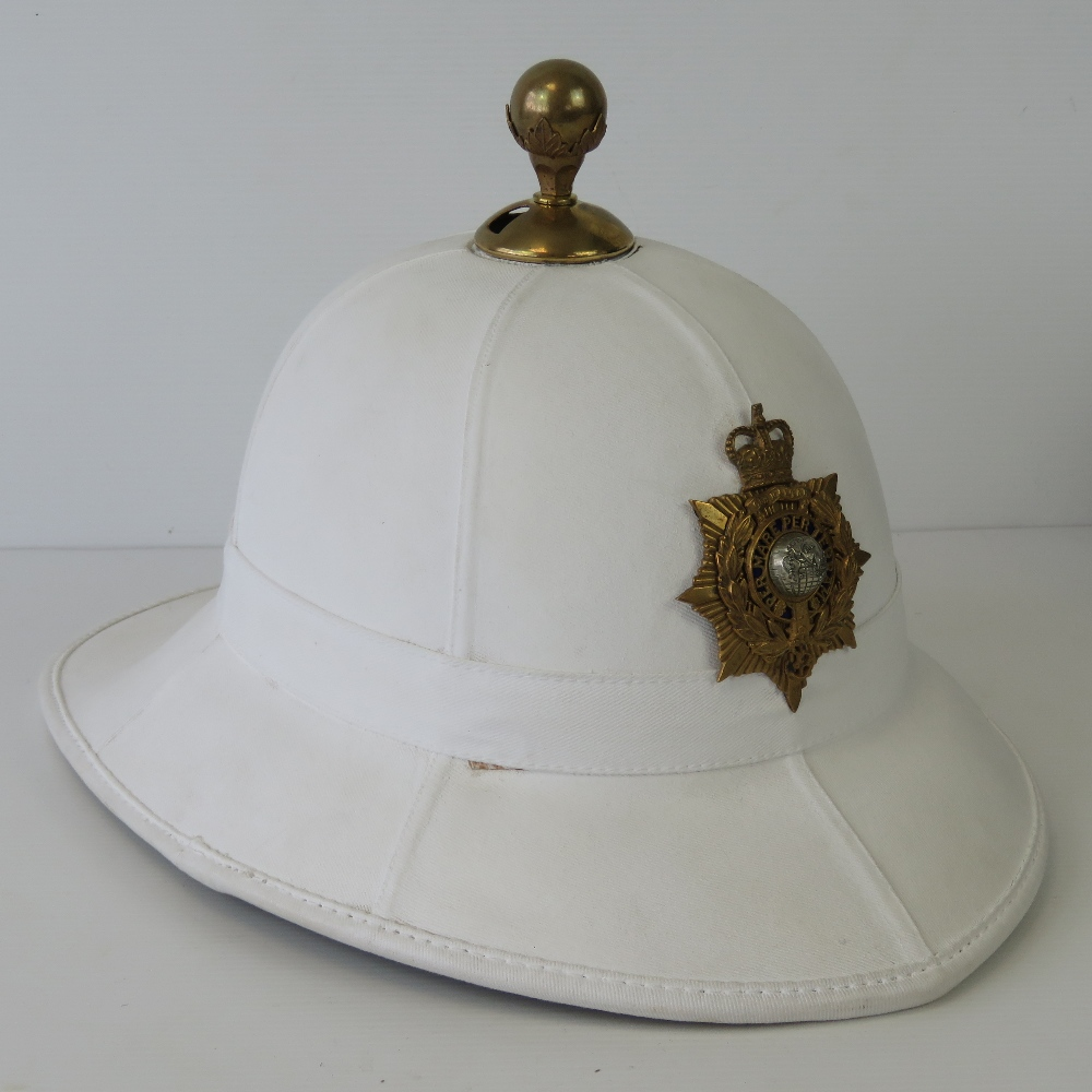 Lot 64 - A Royal Marine Officers pith helmet with
