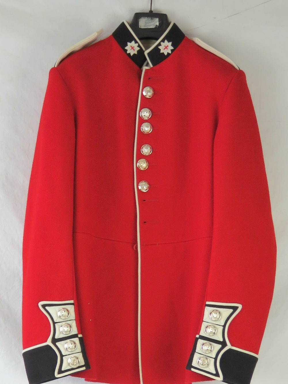 Lot 357 - A Coldstream Footguards red tunic with l