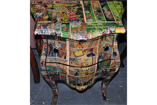 A Louis Xvi Design Two Drawer Bombe Chest With Comic Book Decoration