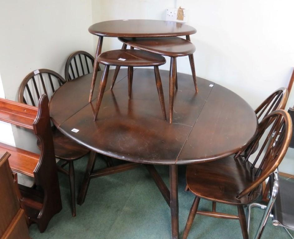 Lot 551   An Ercol dark wood dropleaf dining table with four Ercol hoop  back dining. An Ercol dark wood dropleaf dining table with four Ercol hoop back