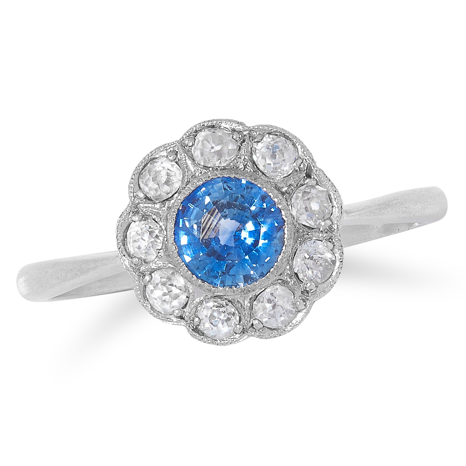 SAPPHIRE AND DIAMOND CLUSTER RING set with a round cut sapphire in a border of round cut diamonds,