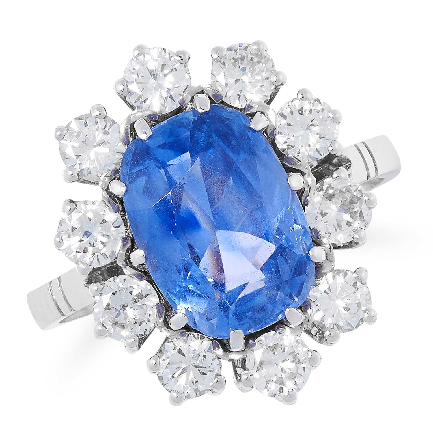 4.15 CARAT CEYLON NO HEAT SAPPHIRE AND DIAMOND CLUSTER RING comprising of an oval cut sapphire of