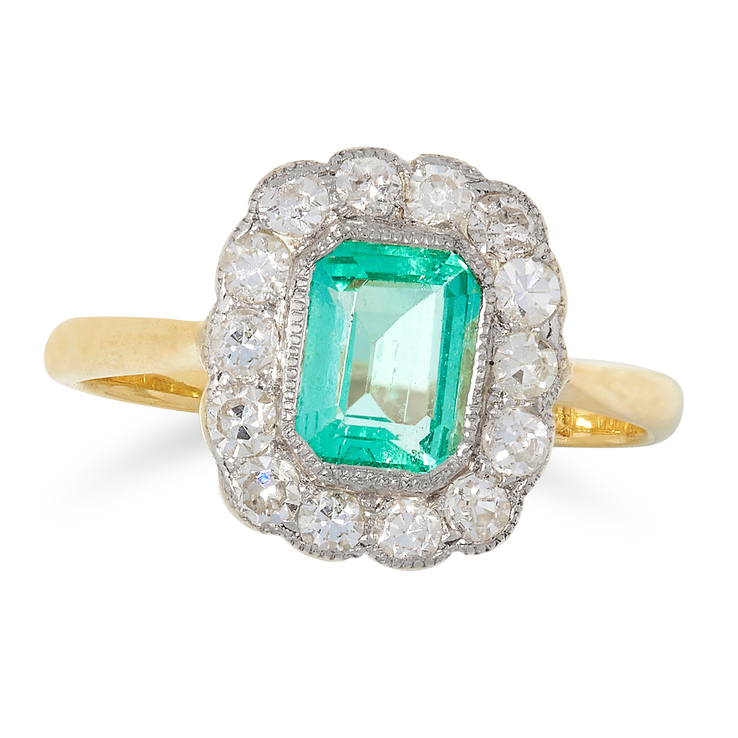 EMERALD AND DIAMOND CLUSTER RING set with an emerald cut emerald in a border of round cut