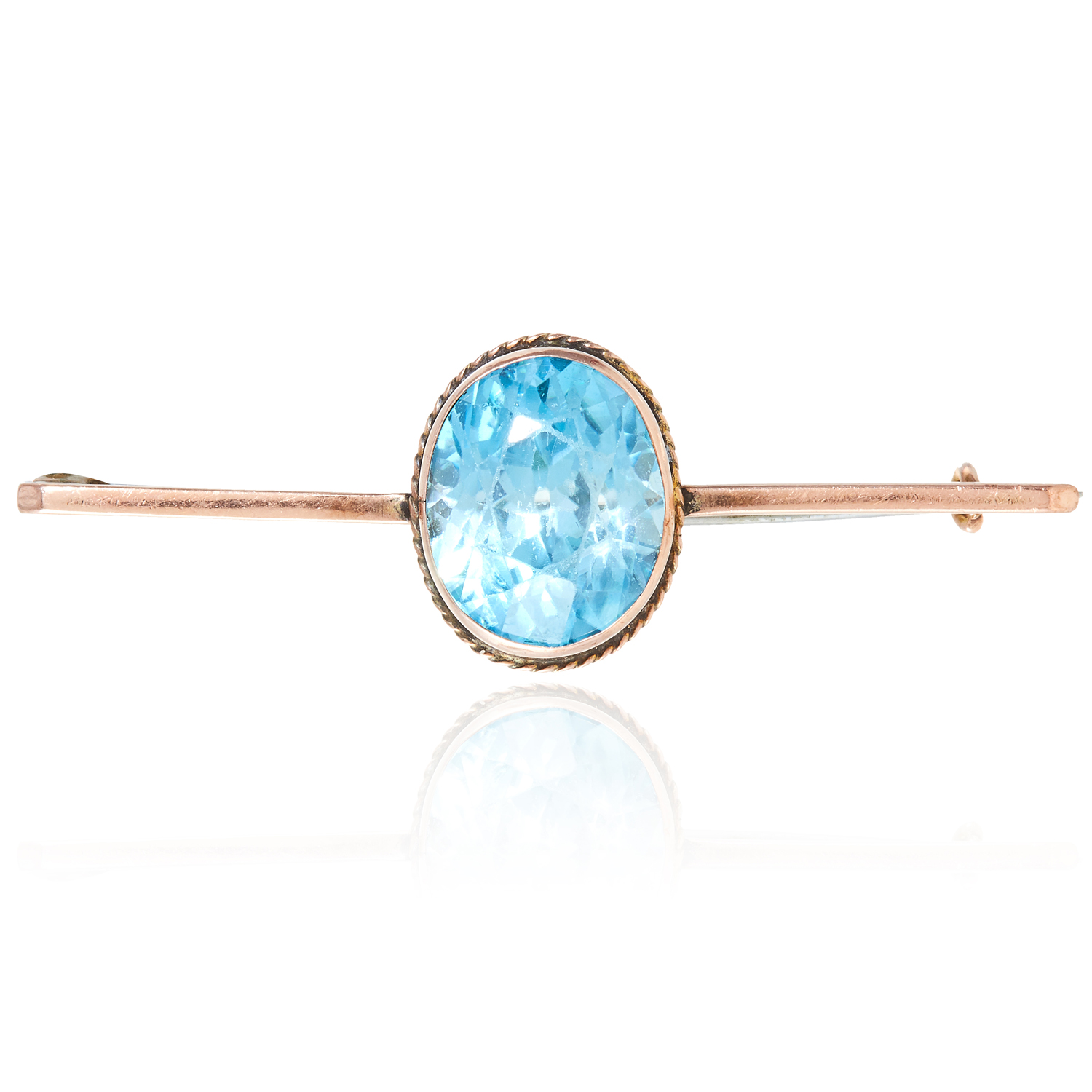 TOPAZ BAR BROOCH set with an oval cut topaz, 5.1cm, 5.0g.