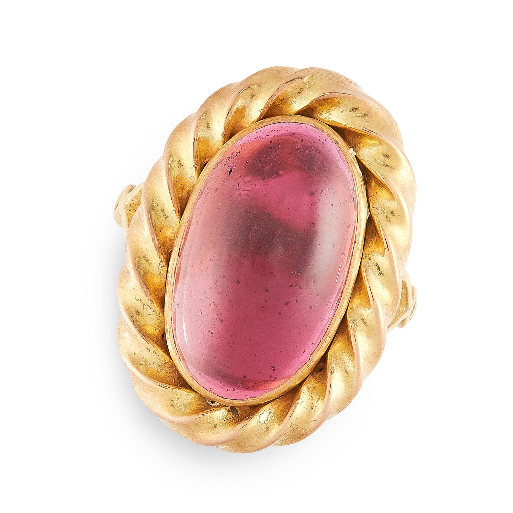 A GARNET DRESS RING in high carat yellow gold, set with a cabochon garnet in a twisted gold