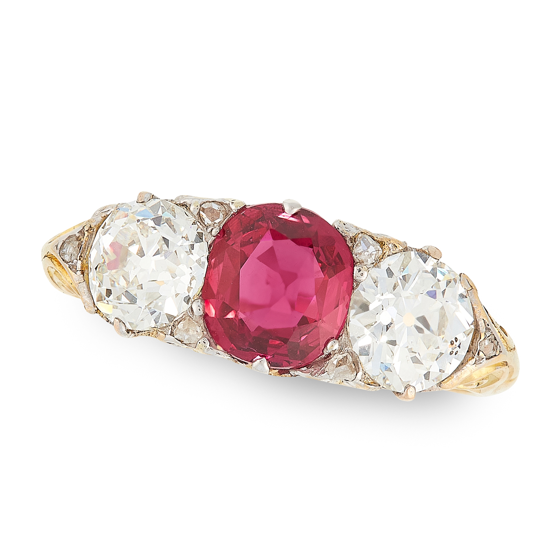 A RUBY AND DIAMOND THREE STONE RING in 18ct yellow gold, set with a cushion cut ruby of 1.12