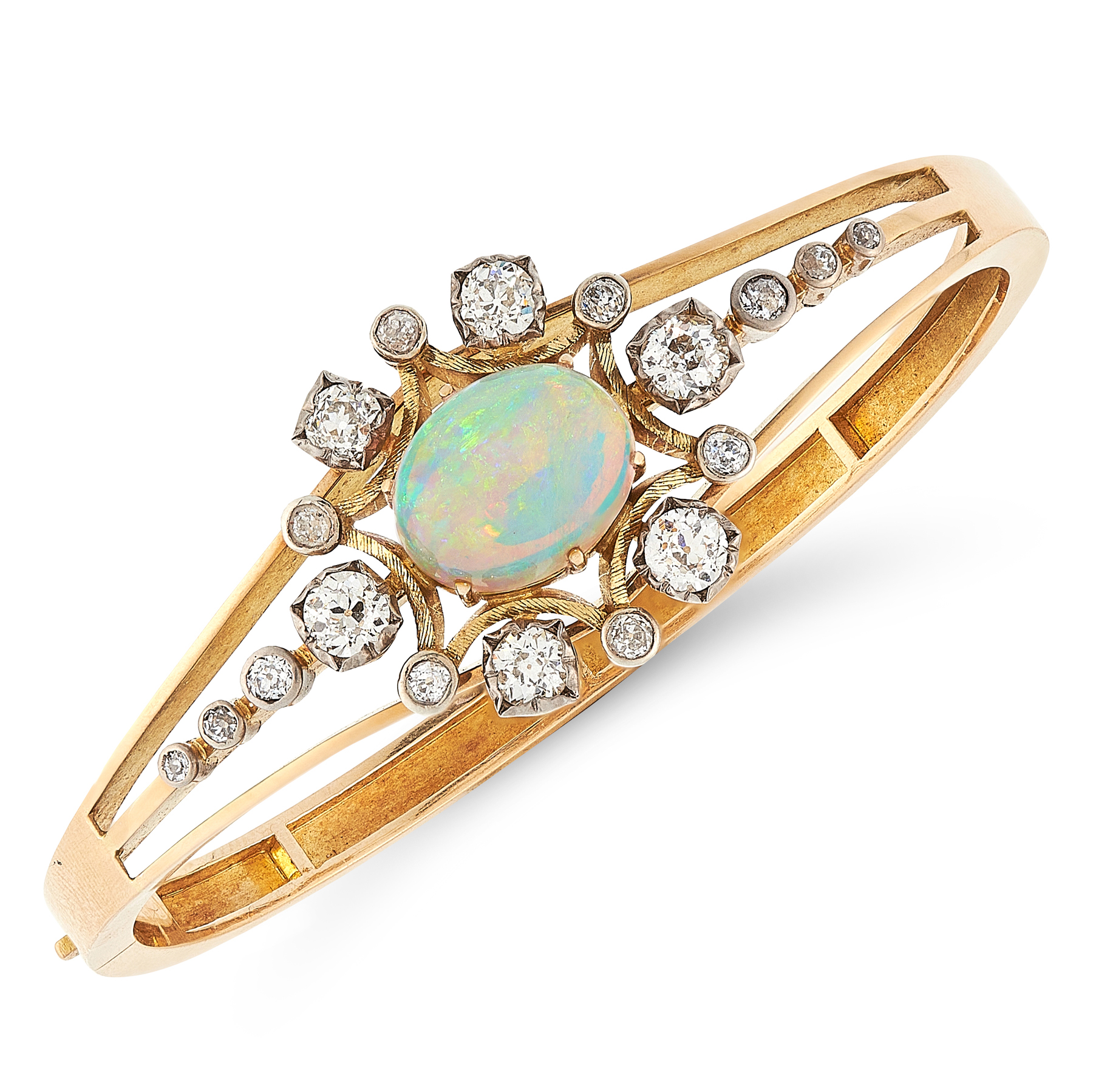 AN ANTIQUE OPAL AND DIAMOND BANGLE in high carat yellow gold, set with a cabochon opal in a border
