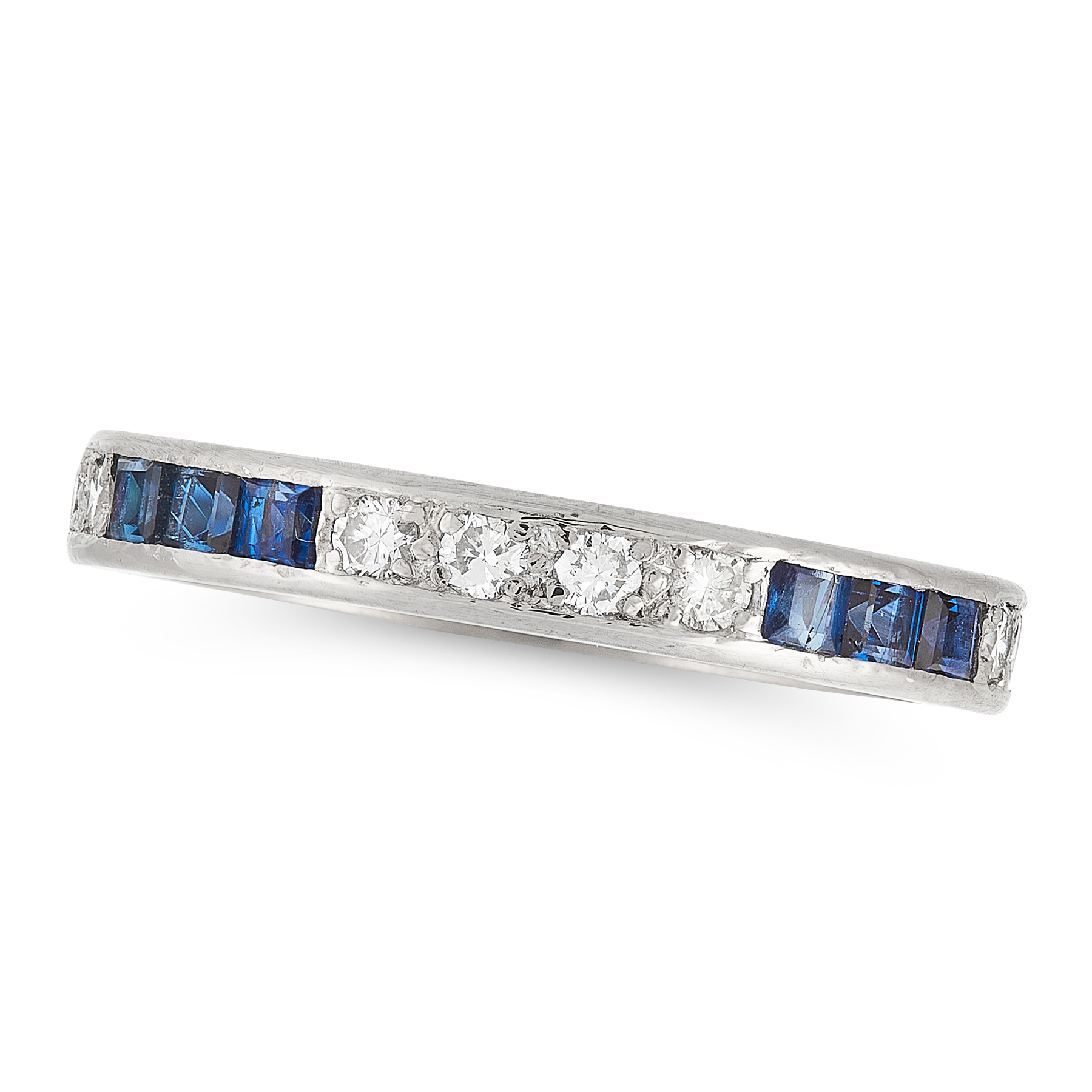 A SAPPHIRE AND DIAMOND ETERNITY RING set with alternating round cut diamonds and step cut sapphires,