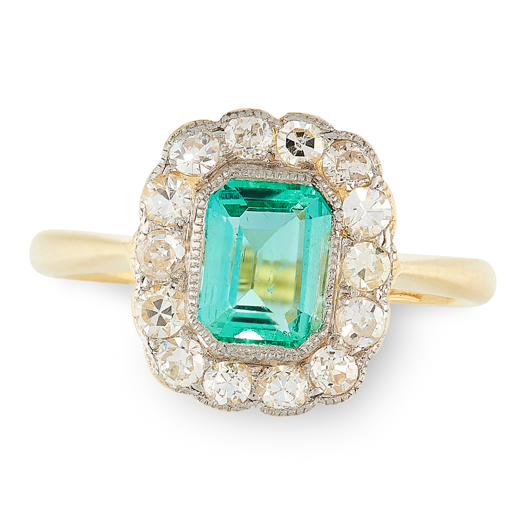 AN EMERALD AND DIAMOND CLUSTER RING in 18ct yellow gold, set with an emerald cut emerald of 0.64
