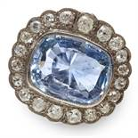 A 14.00 CARAT CEYLON NO HEAT SAPPHIRE AND DIAMOND CLUSTER RING in 18ct white gold, set with an