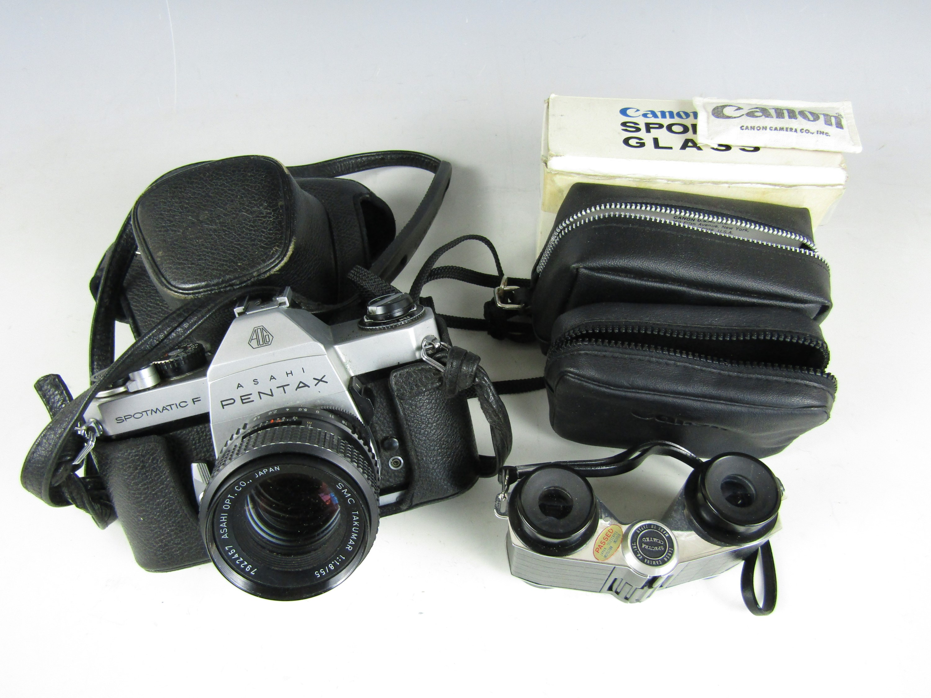 Lot 26 - A vintage pair of Canon 3X sports glasses together with a Pentax Spotmatic F camera