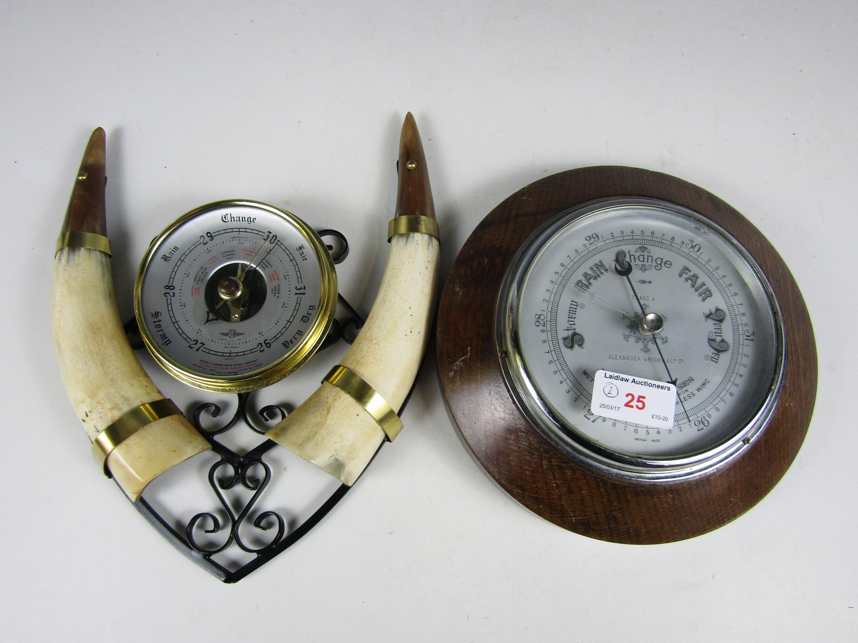Lot 25 - An oak framed circular barometer together with a novelty cows horn barometer