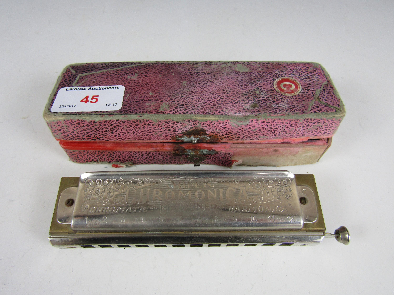 Lot 45 - A cased Chromatic harmonica
